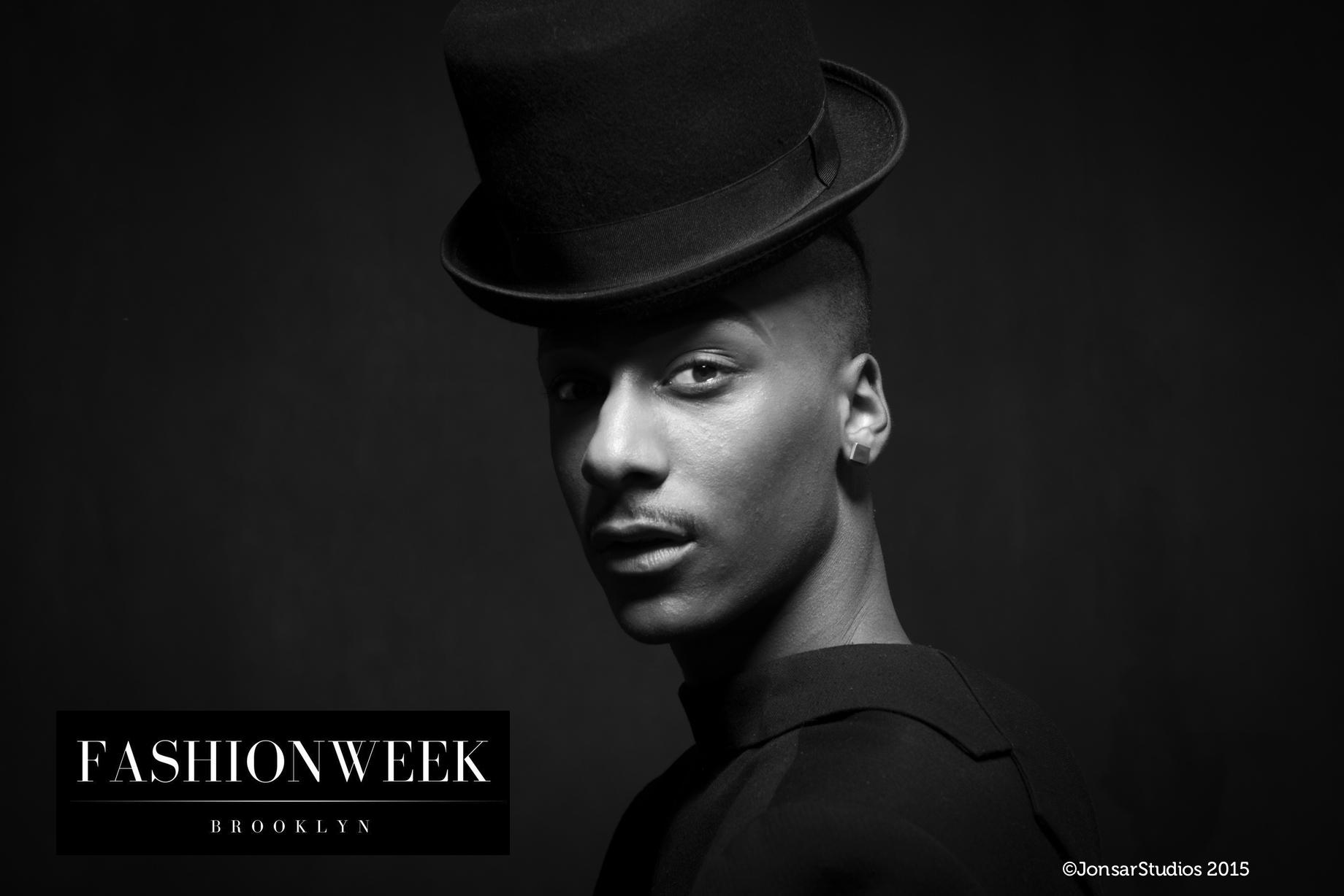 Black and White Portrait of Man on Black Background wearing Black Hat