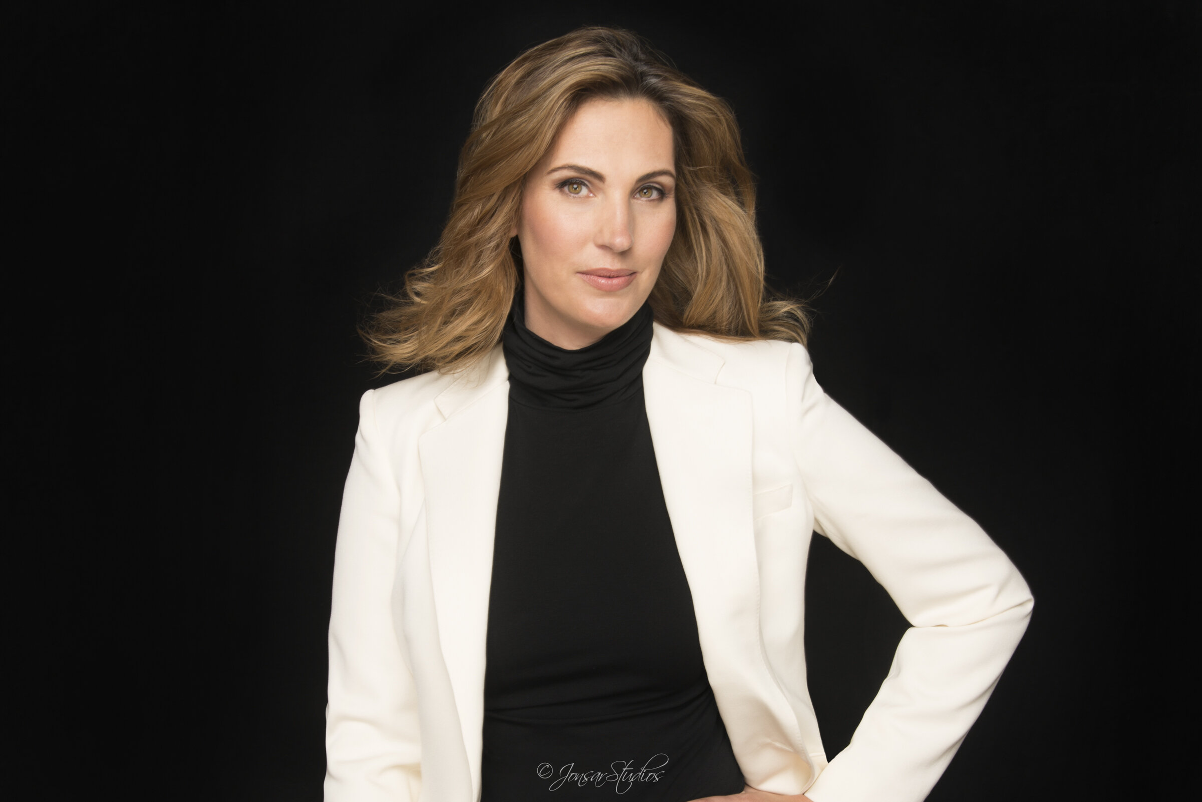 Corporate Headshot of Executive Woman on Black Background