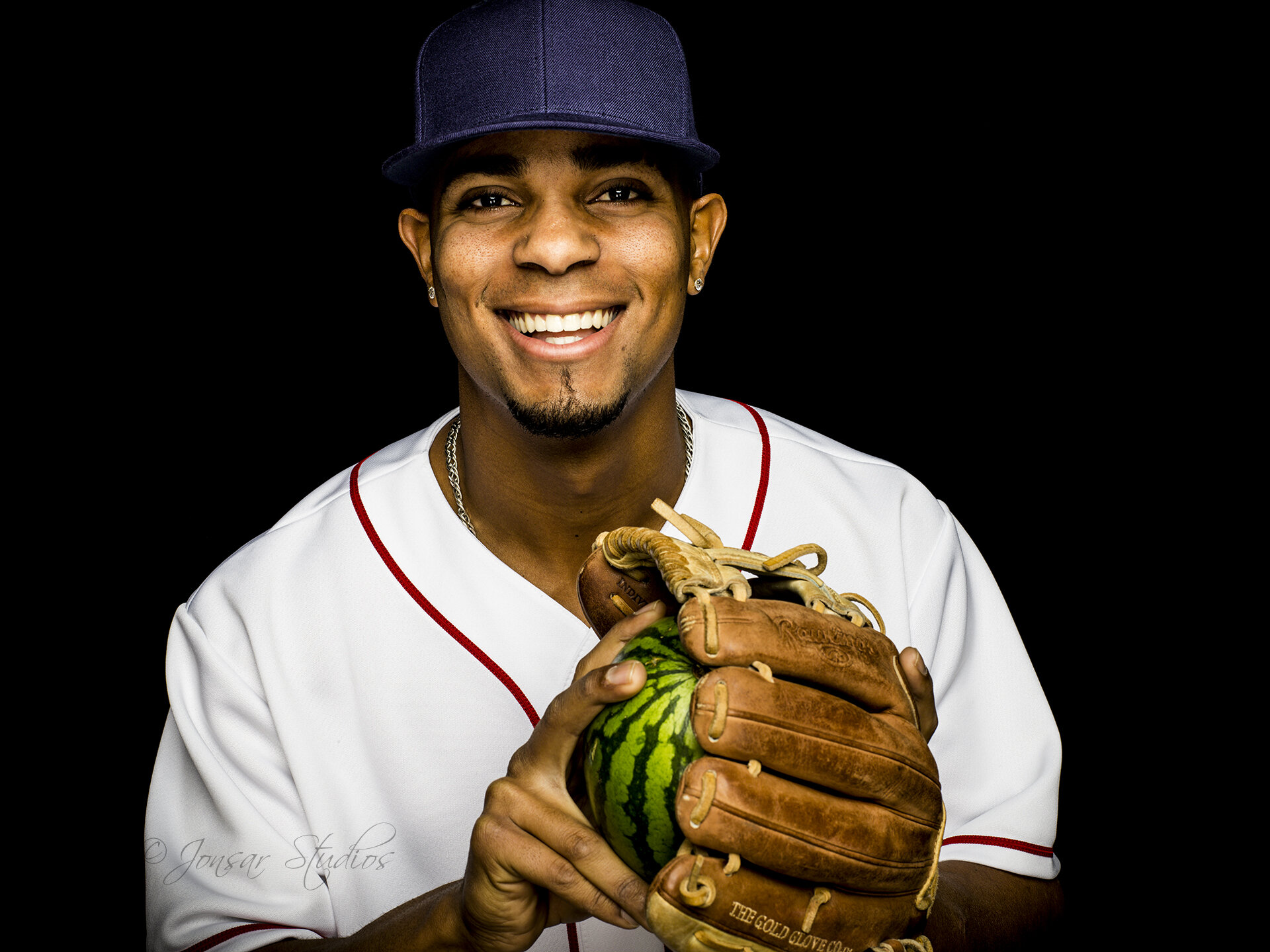 Portrait of Xander Bogaerts with watermelon in his glove