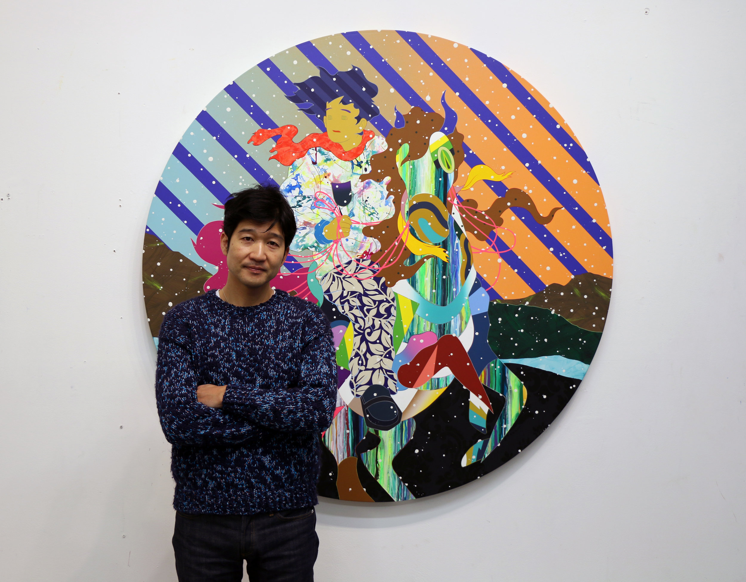 Matsu next to his artwork for MTV RE:DEFINE,  It's Not Up To You .