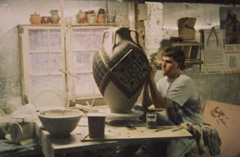 Ben Owen III in Ben Owen Pottery Studio Carving Large Vase-1990.jpg