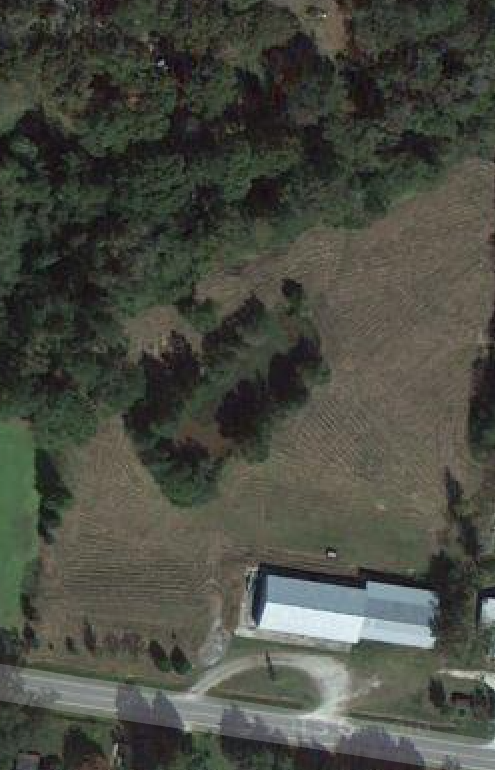 Aerial shot: 3.5 acres, warehouse, land and pond.