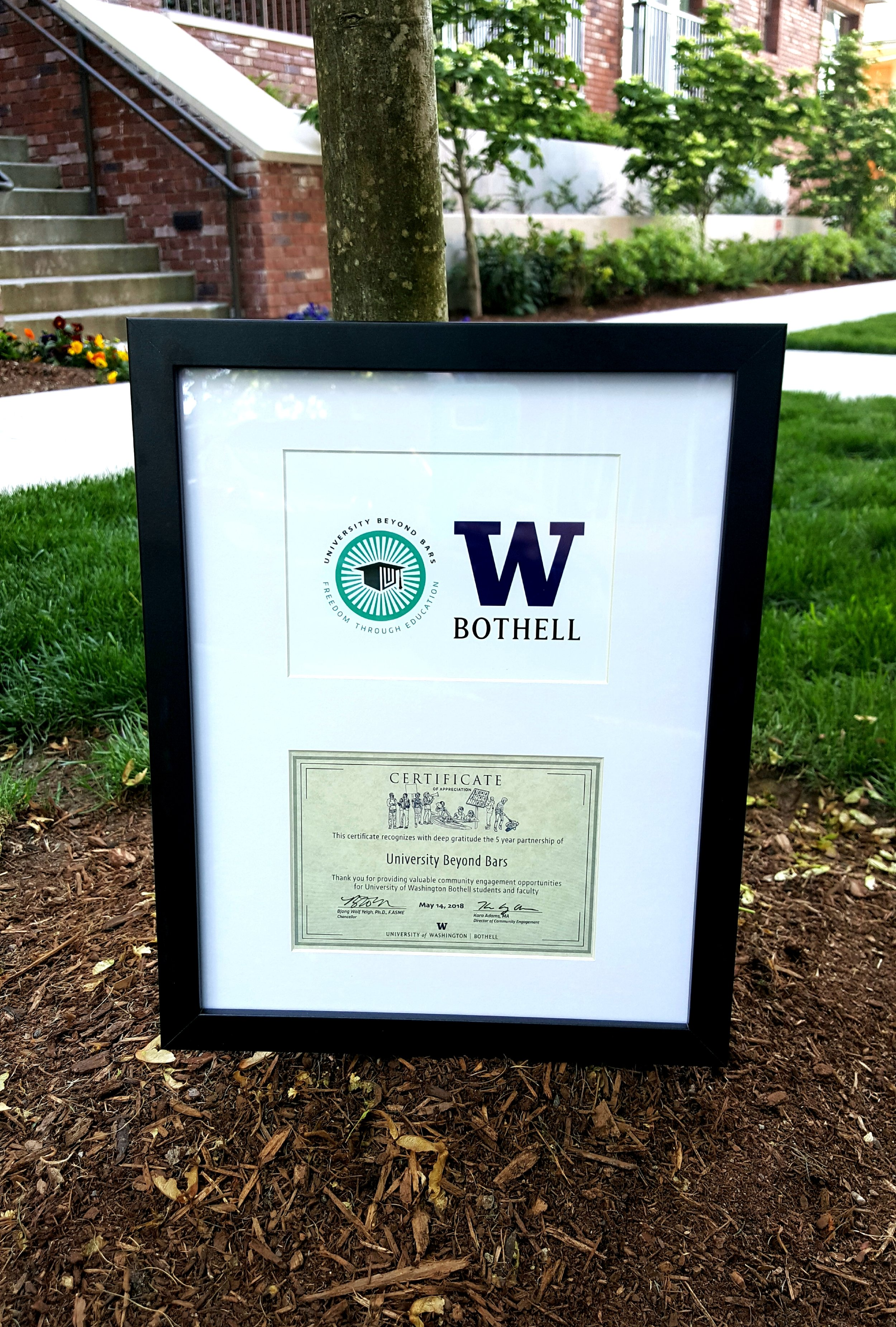 UWB honors UBB with a plaque, recognizing us for our 5-year partnership with UWB