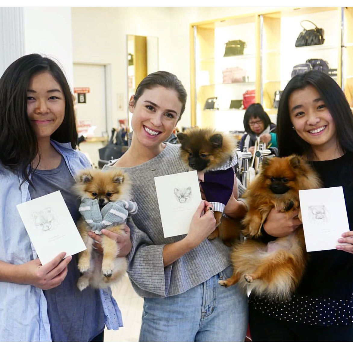 Carrie with owners and pups, after receiving their personal sketches at the Love Thy Beast Event at Bloomingdales Soho location in NYC