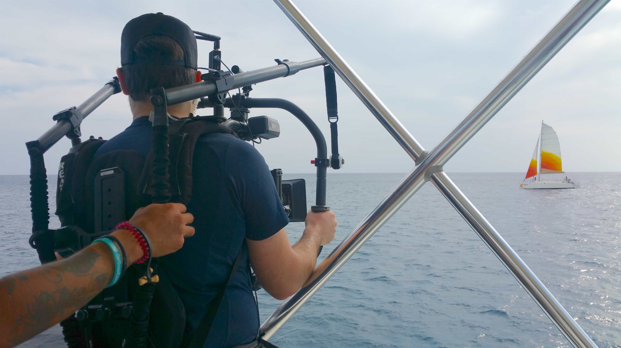 Ryan Hamelin operating Sight & Sound's Movi Pro to film the  Holokai Catamaran  in the distance.