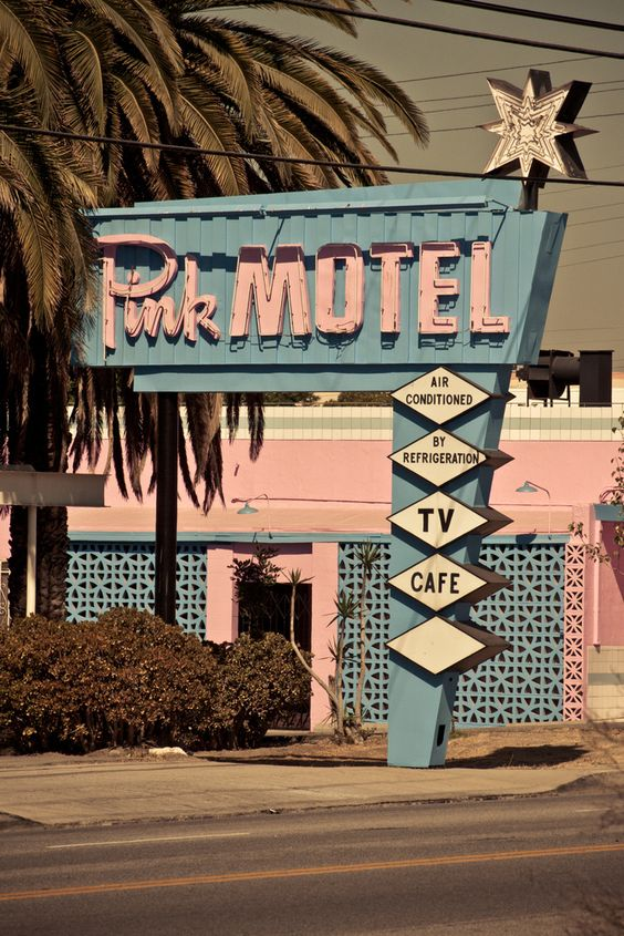 Vintage motel signage - the text, colors, and design is so indicative of the 1950's and 60's.