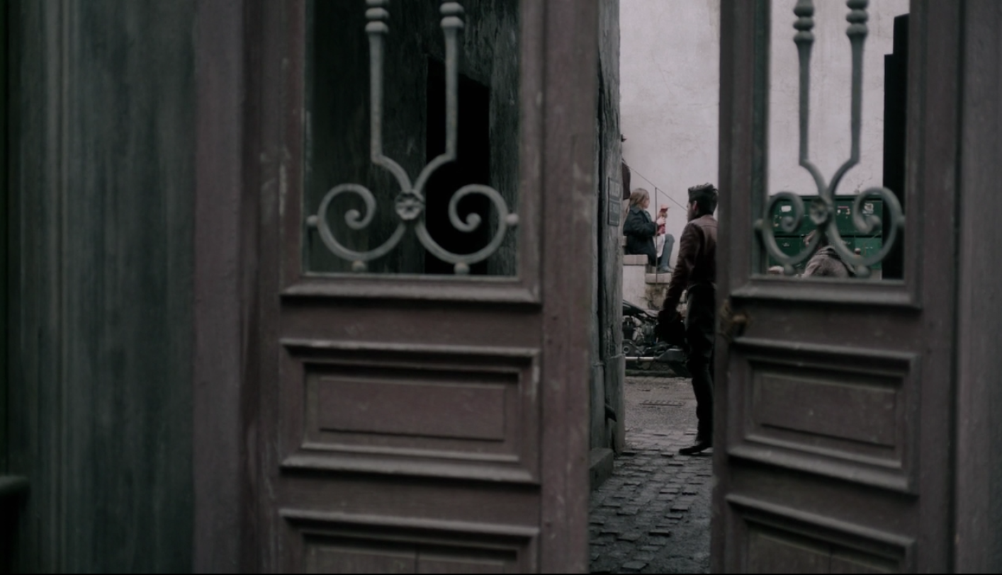 a Parisian courtyard entry from the Amazon Prime show,   The Collection   (Do you love 1950's fashion? Watch it!)