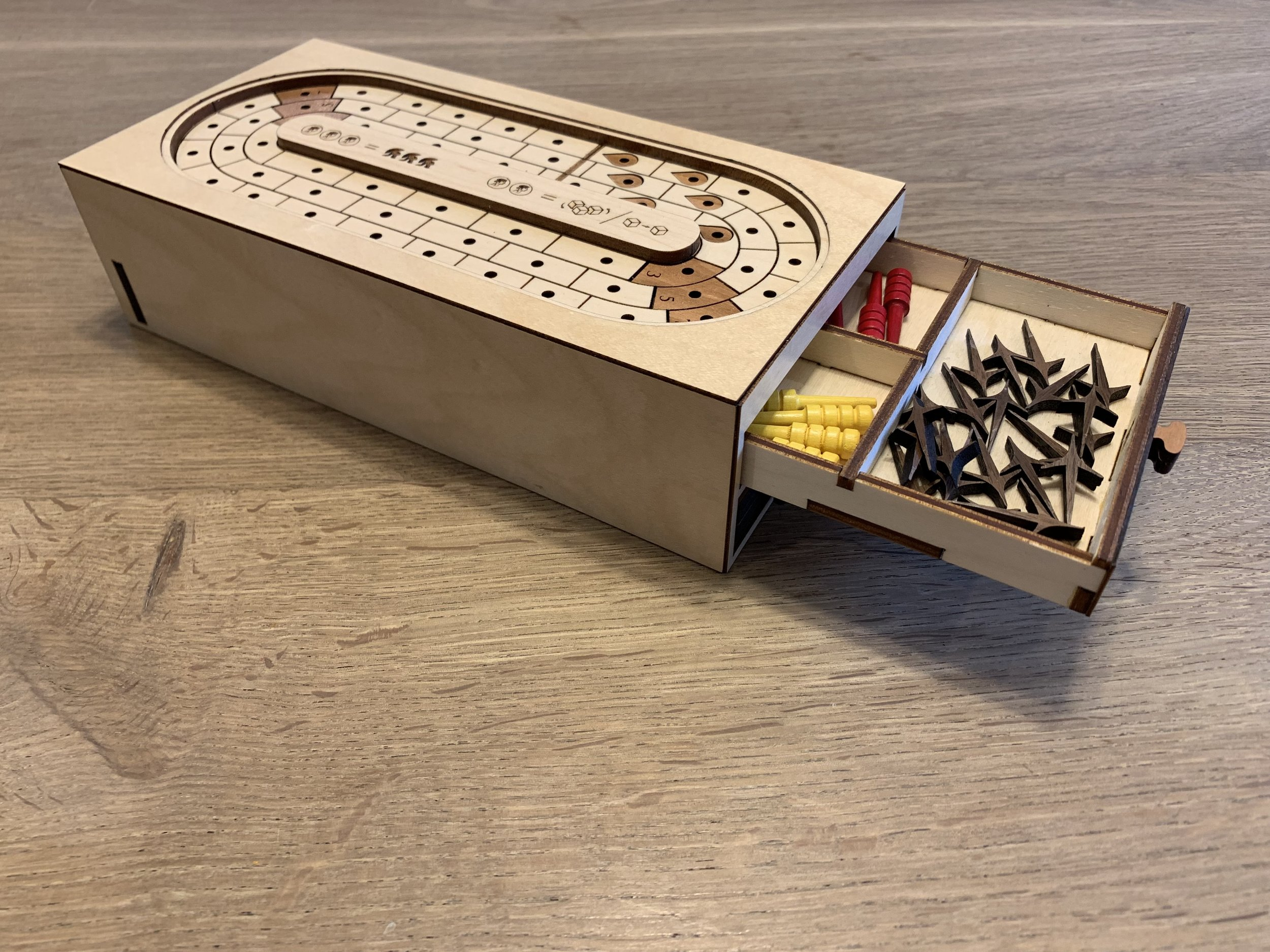 The drawer holds pegs for six players plus all the caltrops you'd ever need.