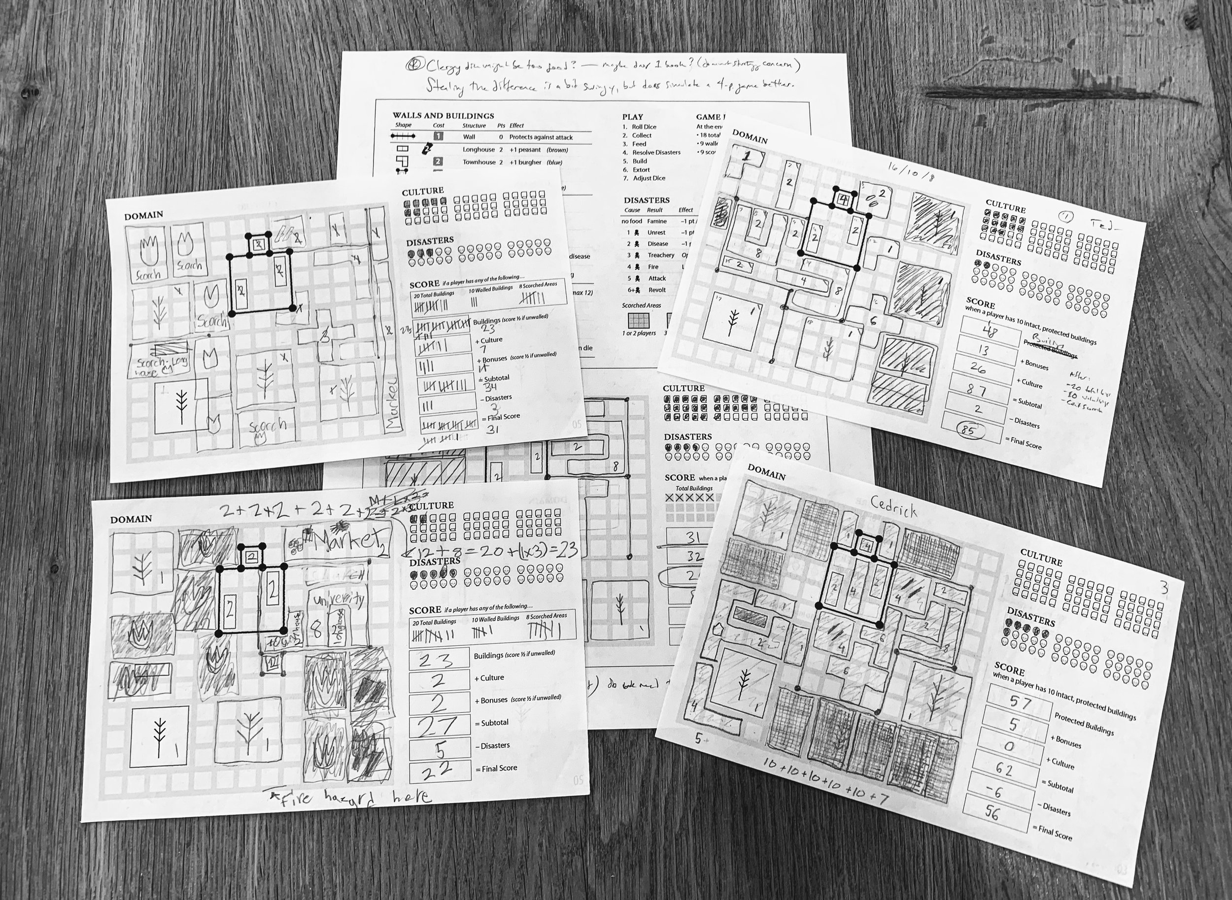 I spent about a year designing the roll-and-write version of  ERA: Medieval Age . Players drew buildings on graph paper and drew walls segments on the lines that separated them. The game also used a reference card for building shapes and a simple pegboard to track resources.