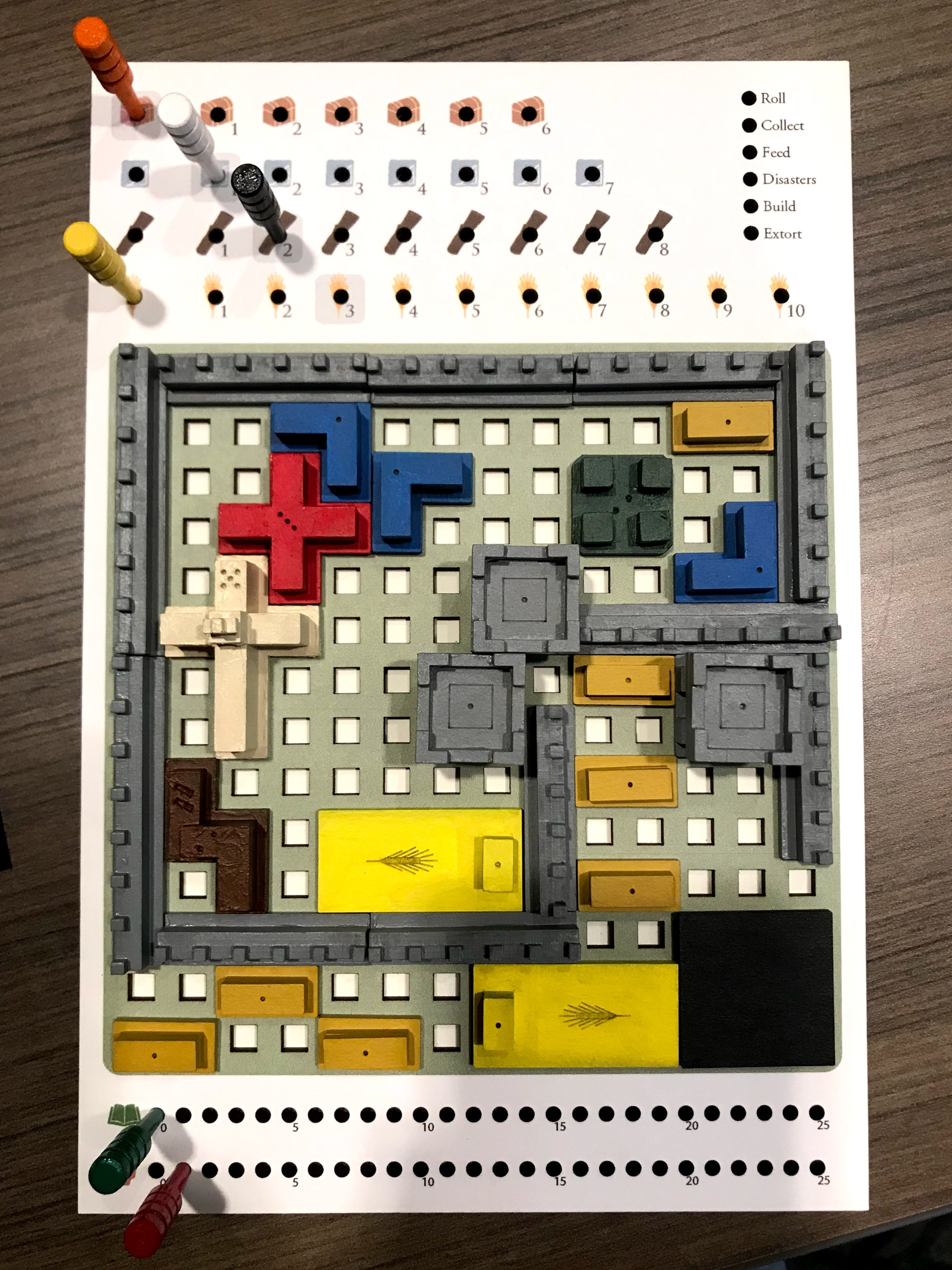 """A robust city at the end of a game. The buildings in the prototype had little """"pips"""" etched into them so you could see how many points they were worth. The published version uses a more robust score sheet satisfies this requirement in a better way."""