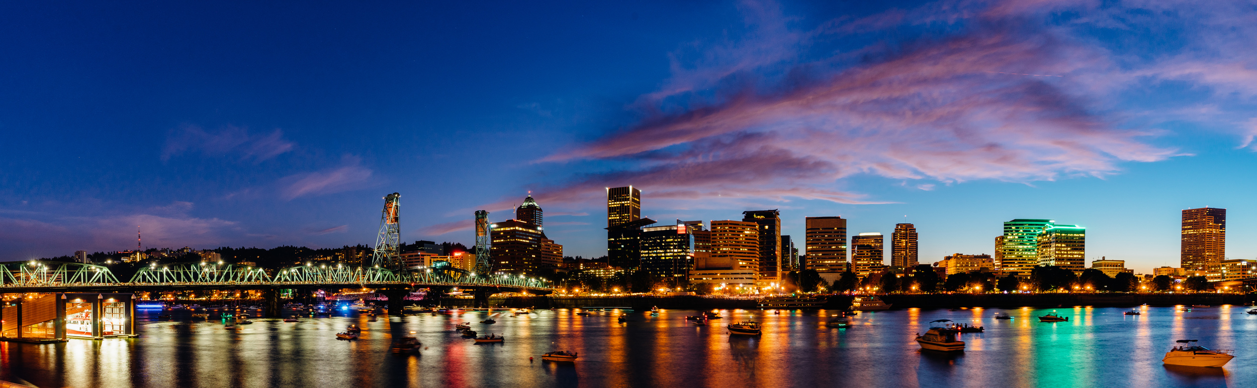 A panoramic view of downtown  Portland  at dusk from across the Willamette River