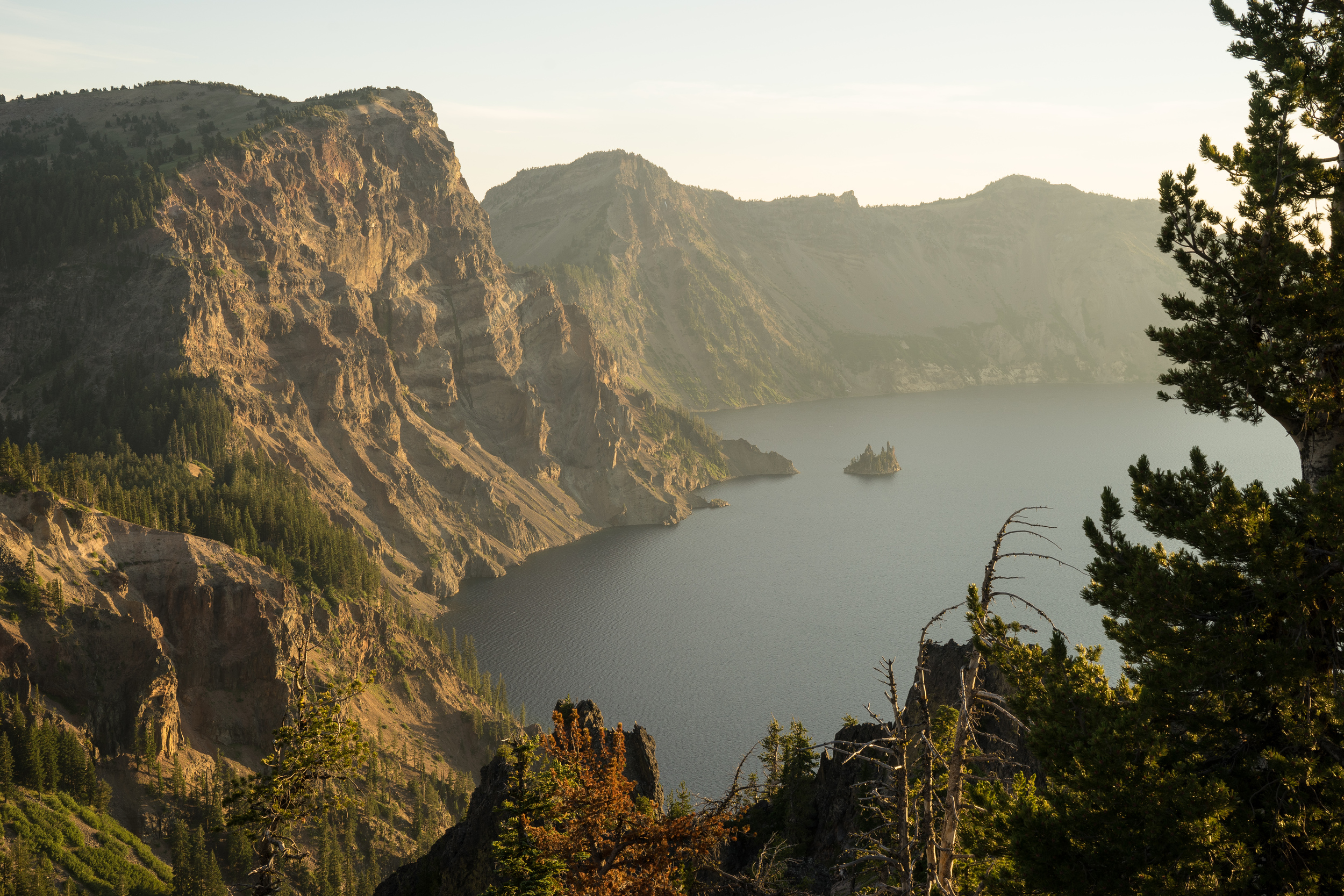 Located on the east rim of Crater Lake is the  Phantom Ship . It got its name from the fact that it tends to appear and disappear in foggy weather like a ghost ship.