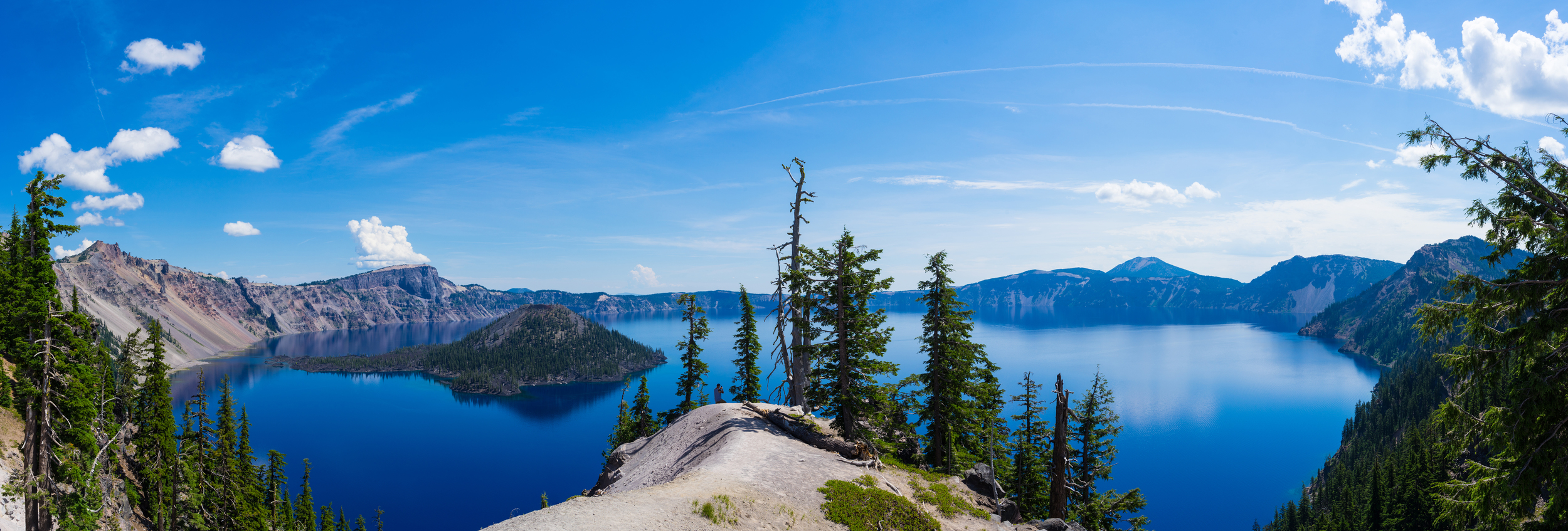Crater Lake  is so vast that I cannot capture it in a single image because none of my lens were wide enough. The island to the left is called  Wizard Island  which rises 750 feet above the surface the lake and actually has its own volcanic crater named the  Witches Cauldron  (Wikipedia).