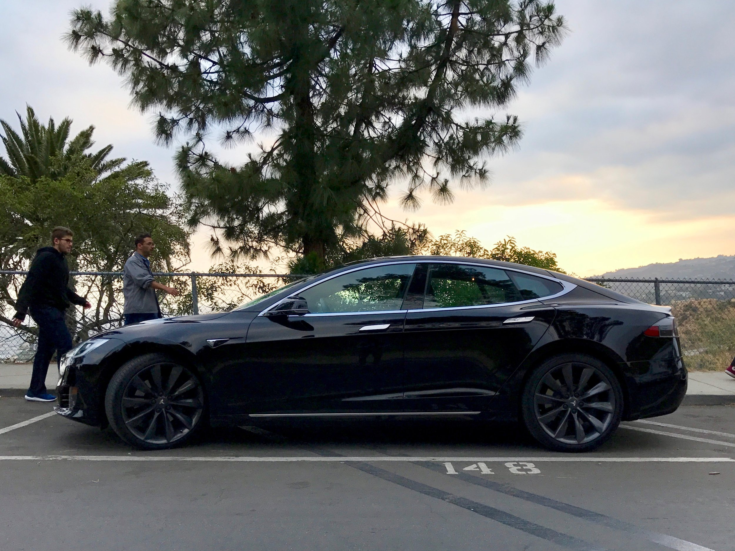 Sideview of the Model S against the sunset at the top of Griffith Park, Downtown Los Angeles.