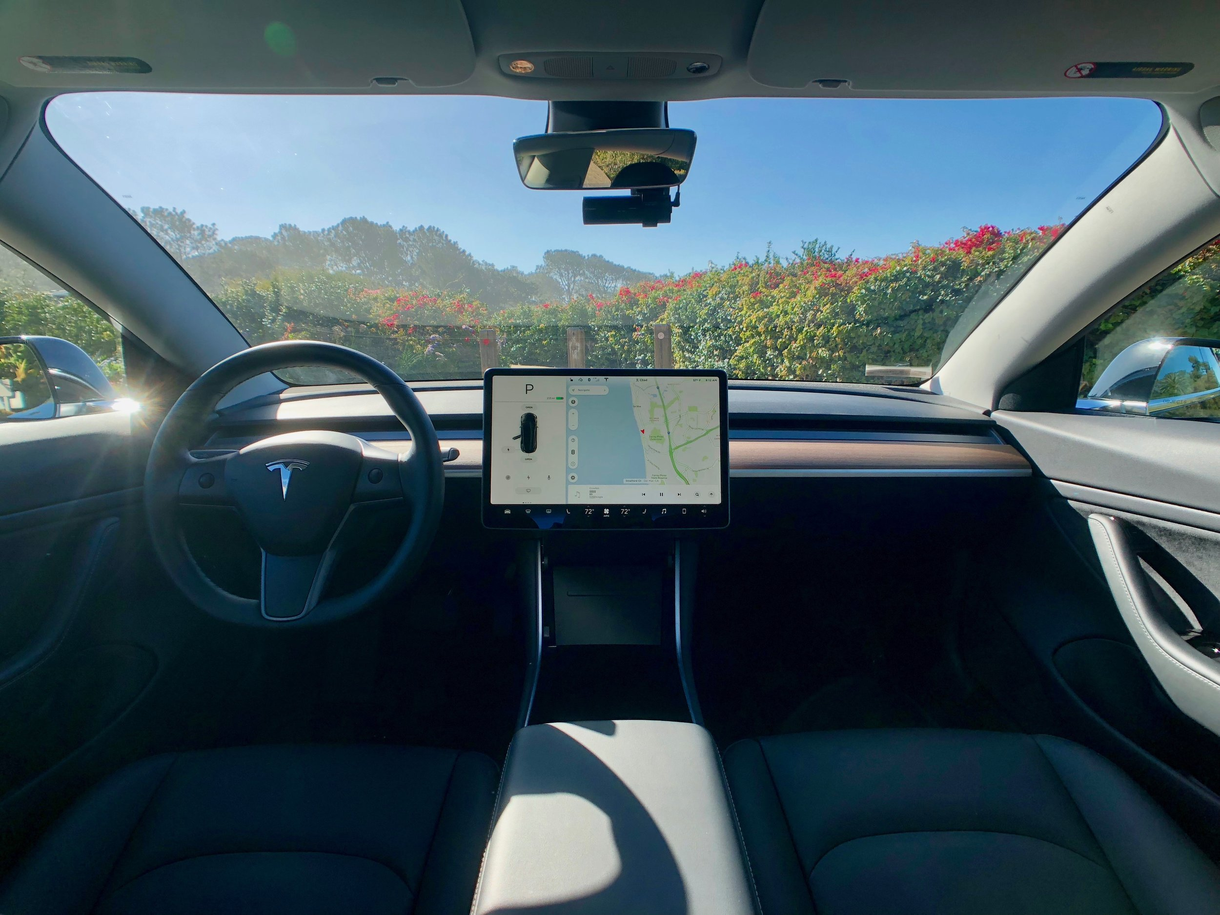 "Minimalists will be pleased with the Model 3 simple and airy interior. The 15"" screen is the center piece of the car."