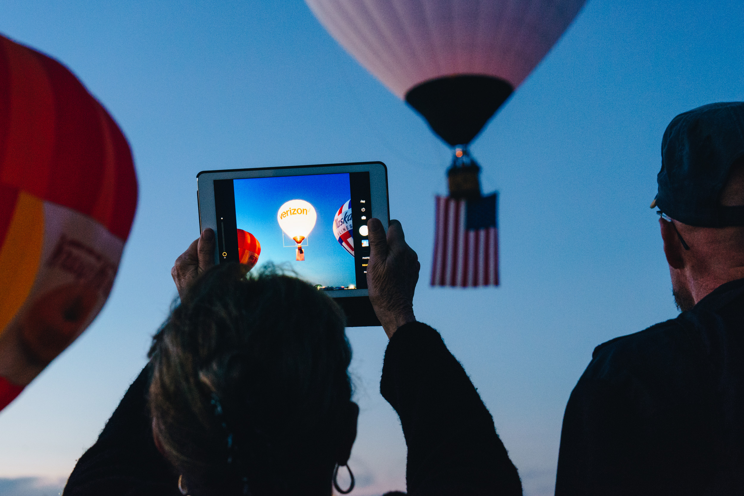 The Sponsor of the Day Verizon balloon lift off with the flag. This marked the beginning of the Mass Ascension