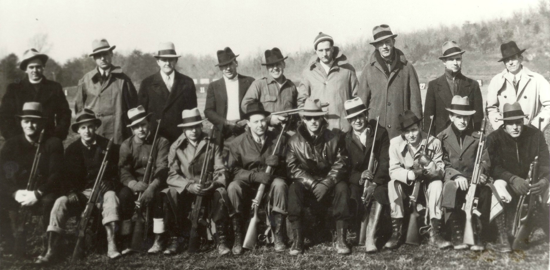 1935 Training Class Of SA Robert E. A. Boyle, SA Norman H. McCabe And Others    SA Boyle served the FBI from 1935-1946. Instructor Frank Baughman is seen here sitting in the bottom row, leather jacket, sunglasses. SA Boyle, wearing a white fedora/dark band is seated immediately to Baughman's left side. Also identified in the photo is SA Norman H. McCabe, standing in rear, 3rd from the right. SA Robert Boyle's son, Mike, is now a retired FBI Agent and Mike Boyle's son, Sean, is currently a Special Agent Supervisor with the FBI. (photo courtesy retired SA Mike Boyle as given to him by SA McCabe. Others unidentified. )
