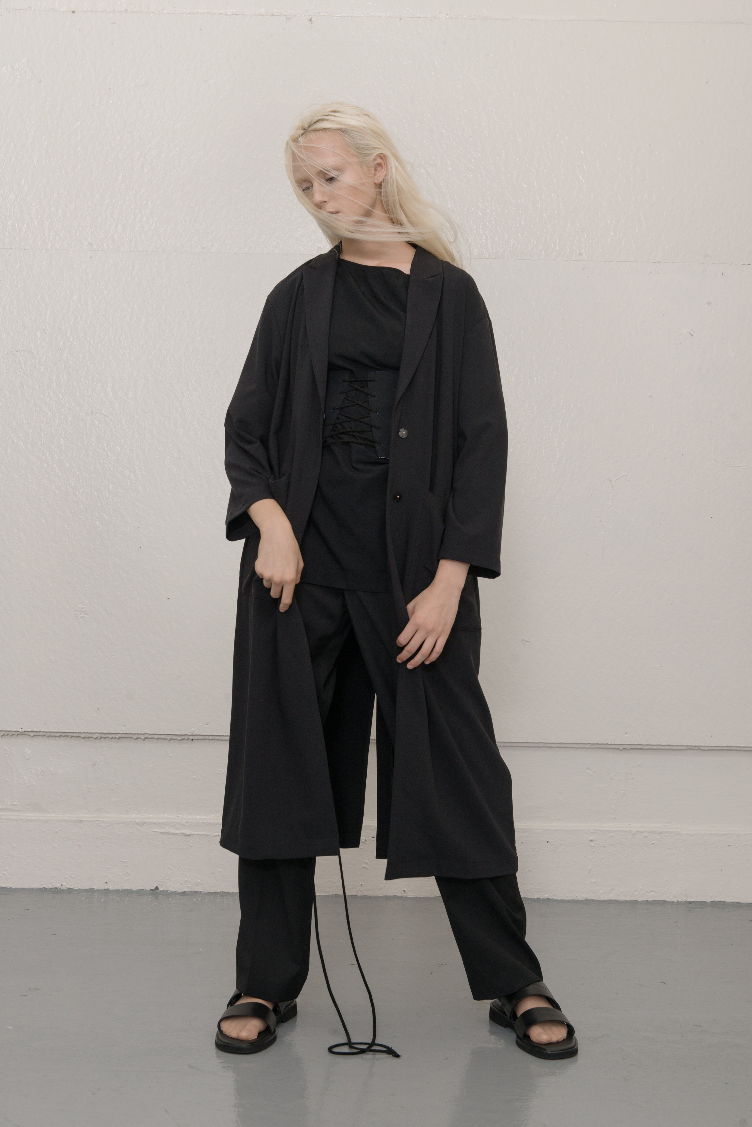 coat STYLIST'S OWN, top COS, pants THEORY, shoes COS