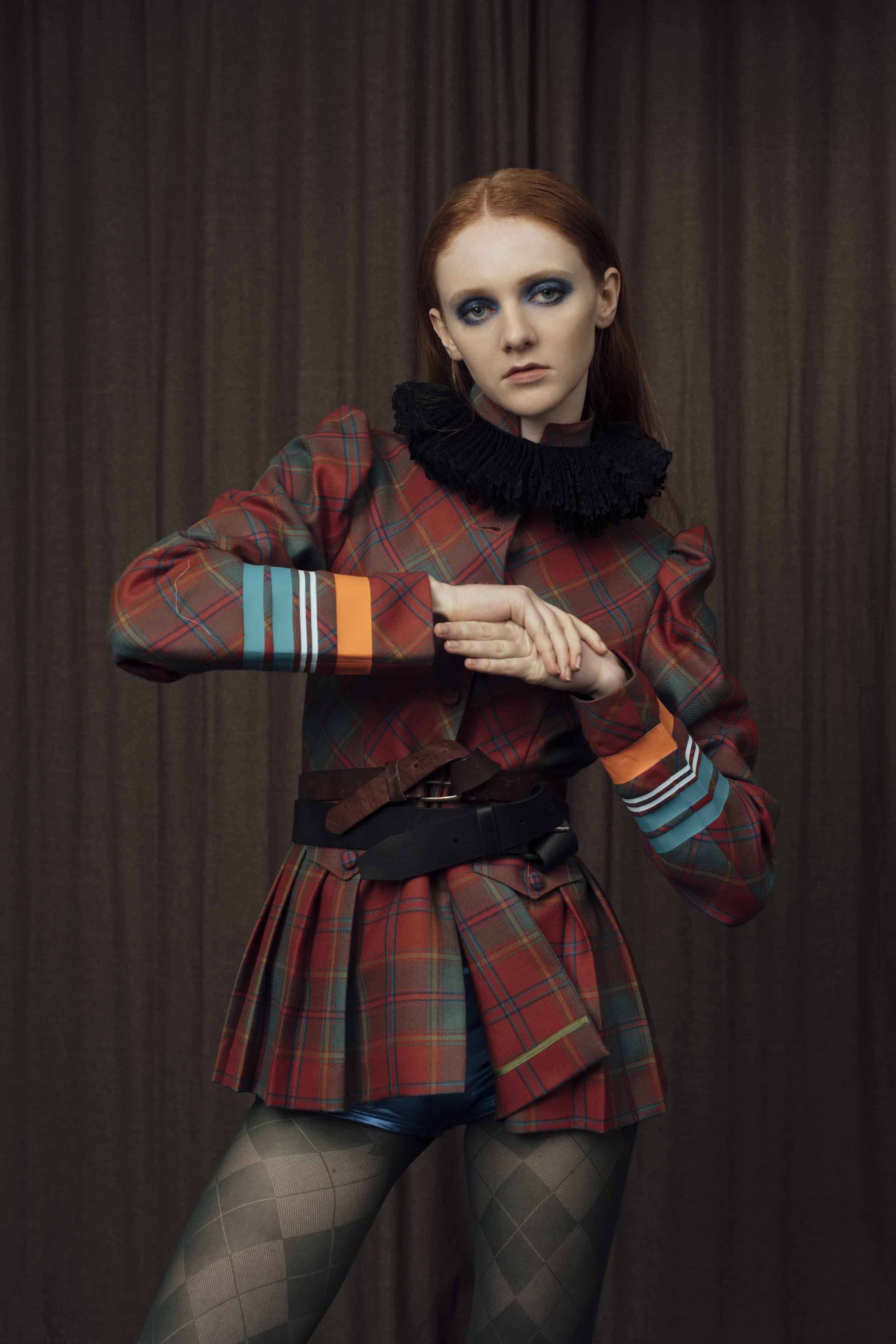 collar COSTUME STUDIO, jacket  BAREIA AHMAD , shorts STYLIST'S OWN .