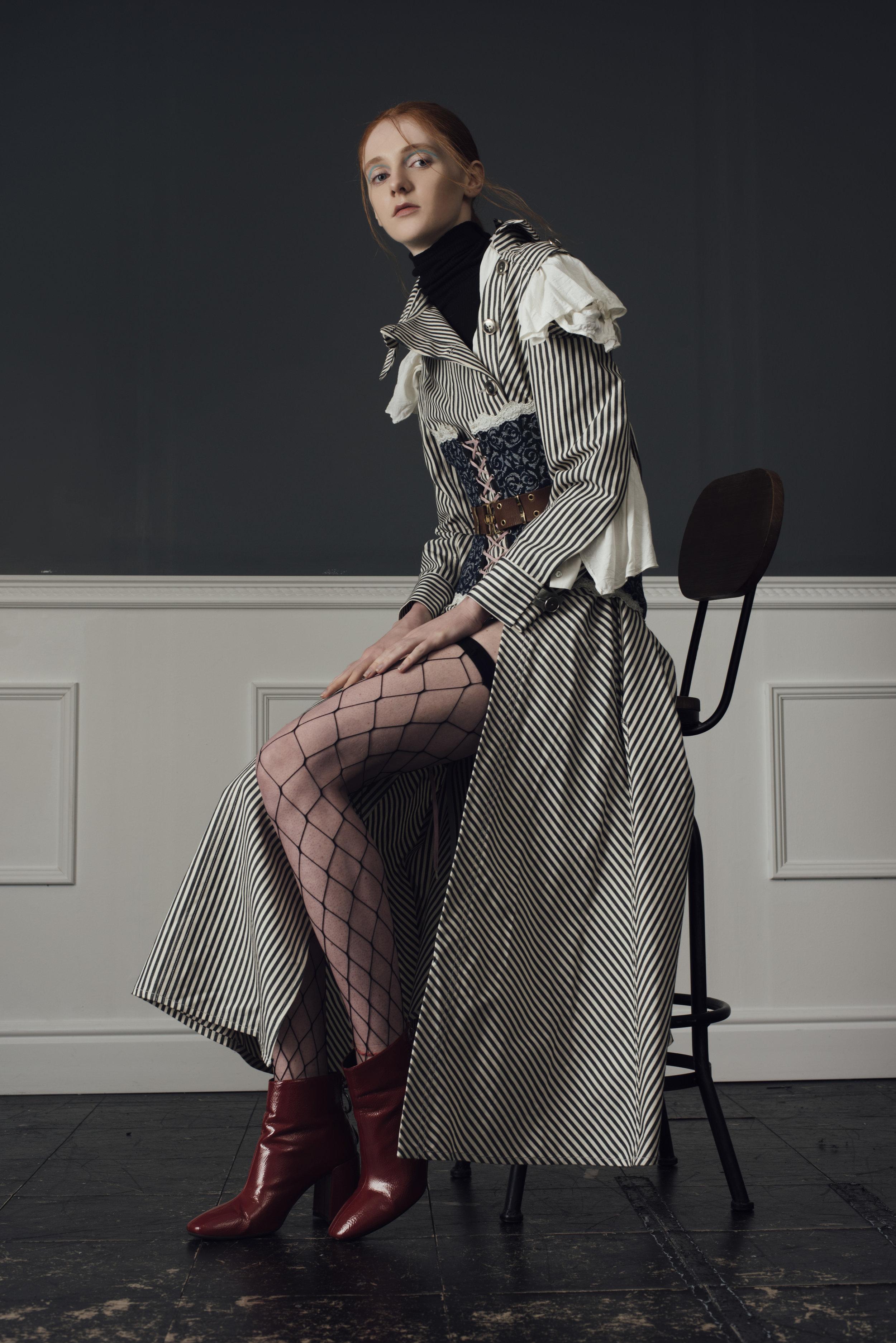 jumper  UNIQLO , blouse STYLIST'S OWN, corset COSTUME STUDIO Vintage dior belt MODES AND MORE,coat  CONSTANCE BLACKBALLER , boots STYLIST'S OWN