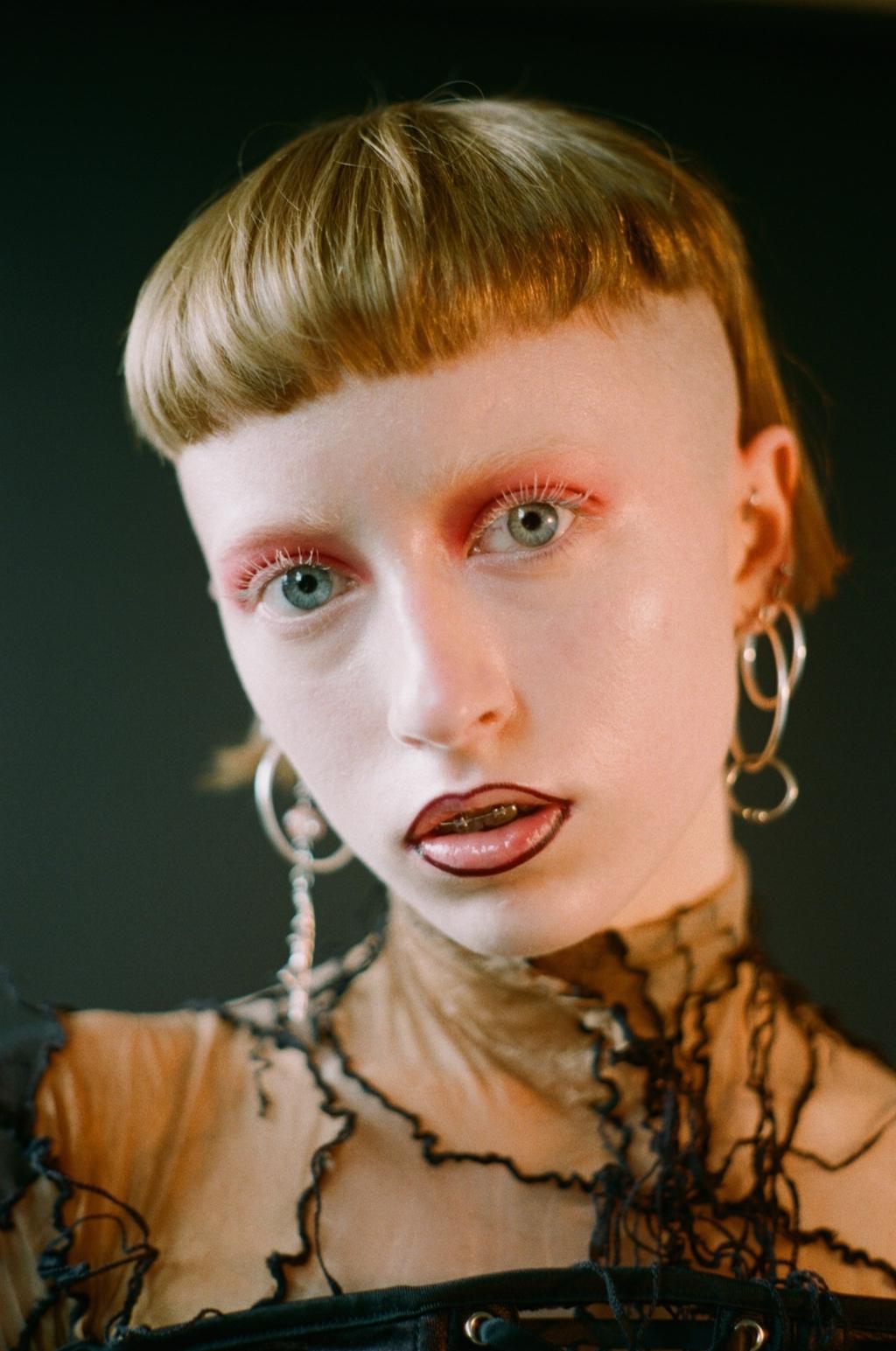 top + trousers Sonia Trefilova, corset STYLIST'S OWN, earrings MODELS OWN