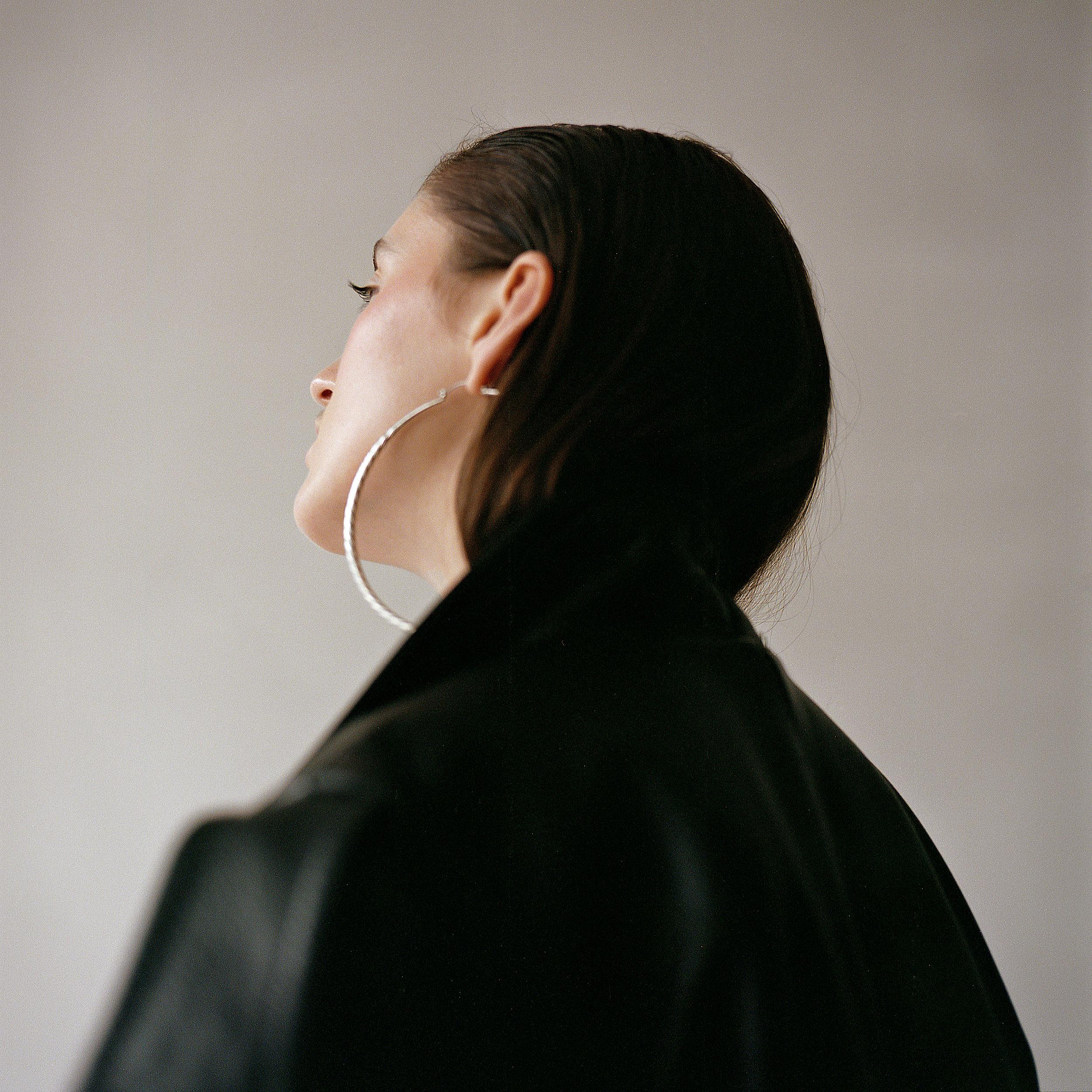 jacket LUOMO STRANO, earrings JENNIFER FISHER,