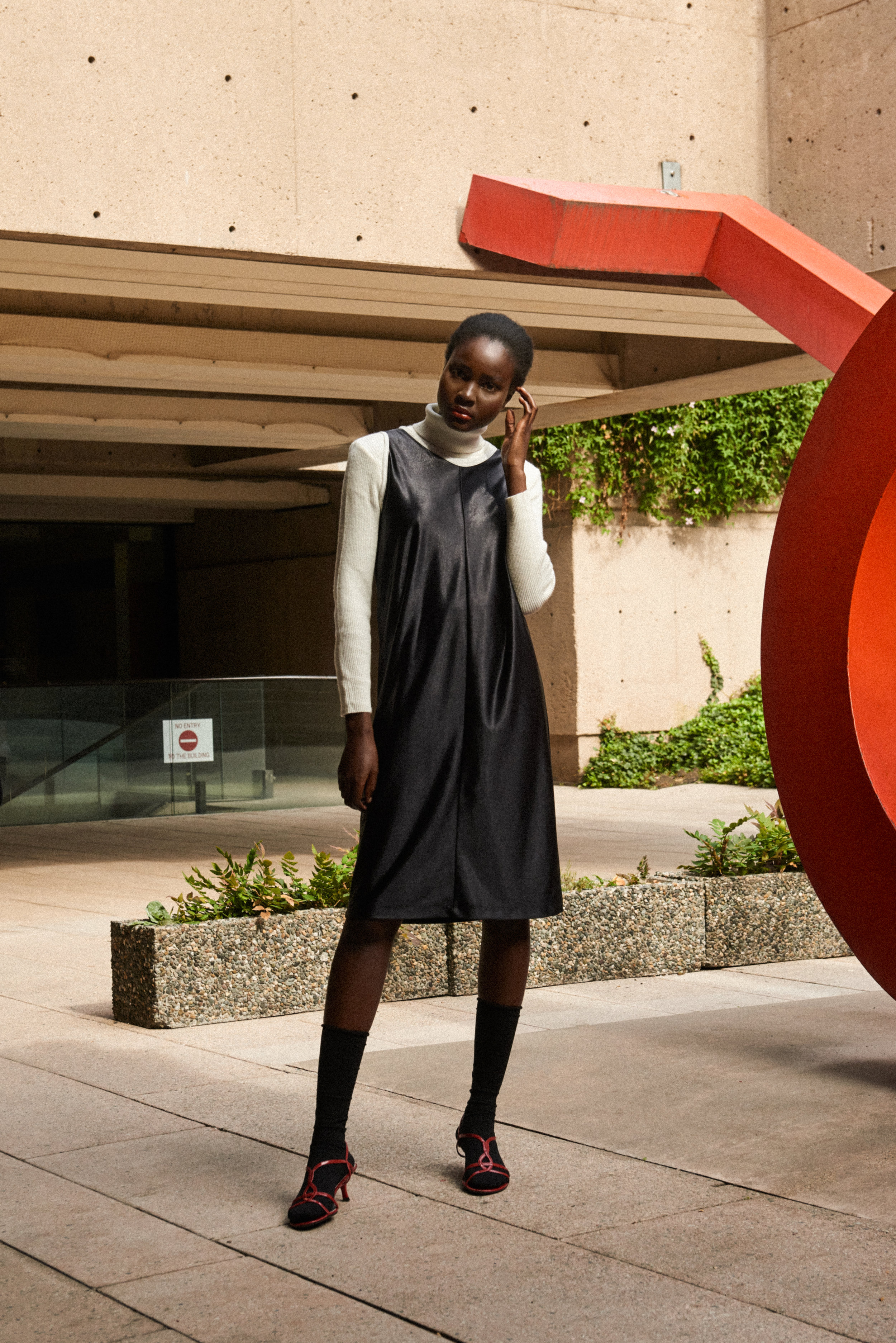 Dress: Mishel Bouilliet Designed and Made in Vancouver, Canada Turtleneck, Footwear: Thrifted