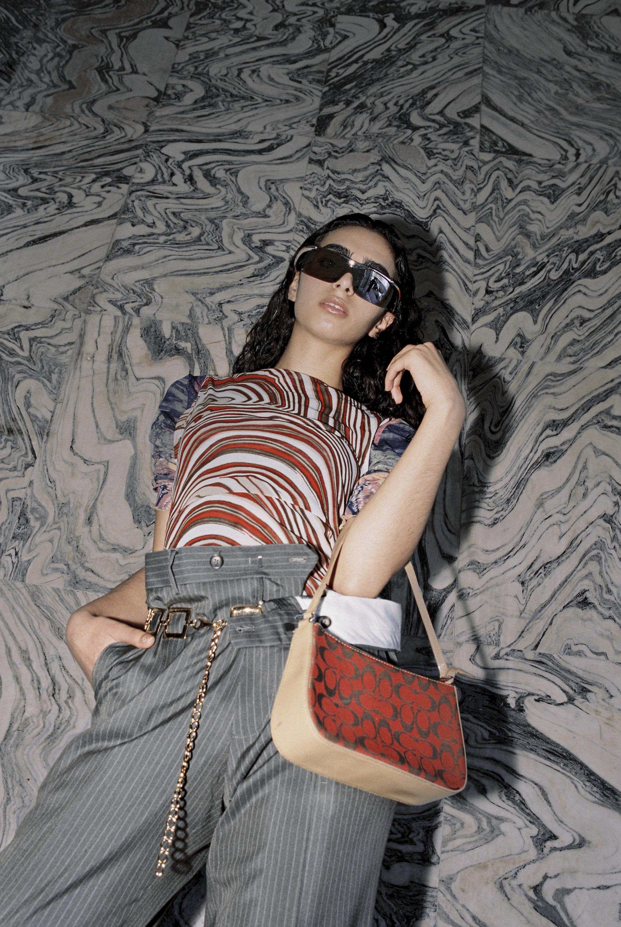 sunglasses Prada, top Mexx, bag Coa