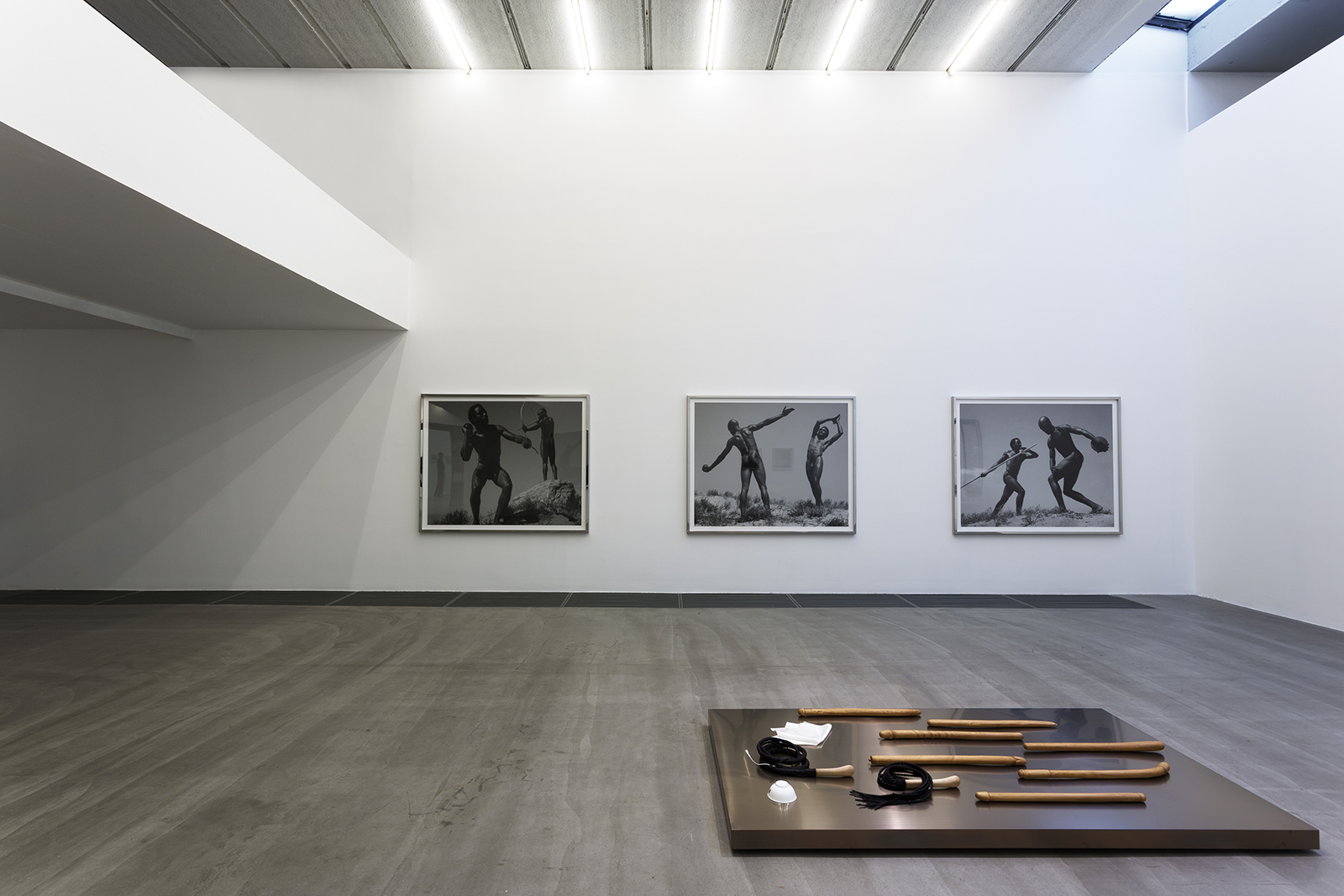 Two videos, three photographs, several related masterpieces, and American art , 2013. Installation view, Galerie Urs Meile, Beijing, China, 2013.