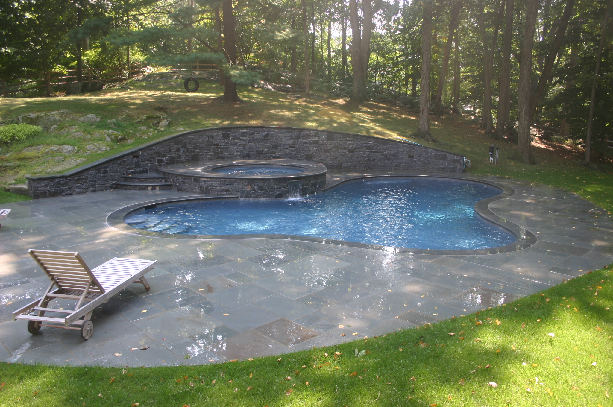 Ref ID  - Freeform Swimming Pool and raised spa with retaining wall in Stamford, CT