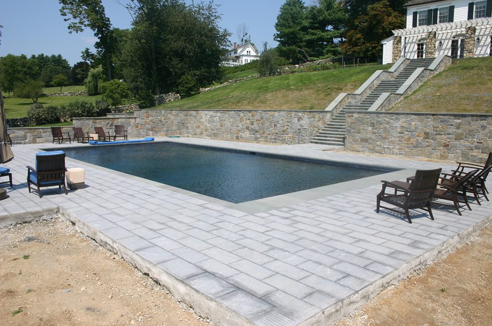 Ref ID  - 44 custom stone steps leading to a 50 foot pool with retaining walls and 1800 square feet of patio in Greenwich, CT