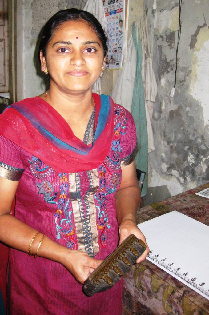 A young woman trains in block printing techniques at the Weaver's Service Center in Bombay.
