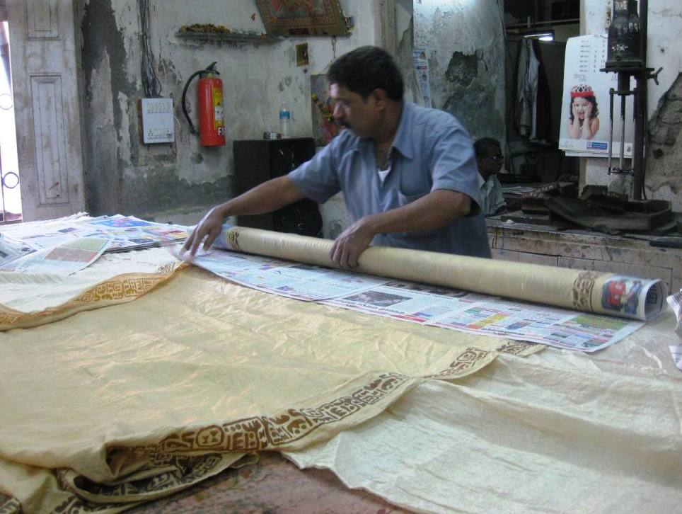 Saris getting ready for a steam which will set the color of the block prints.