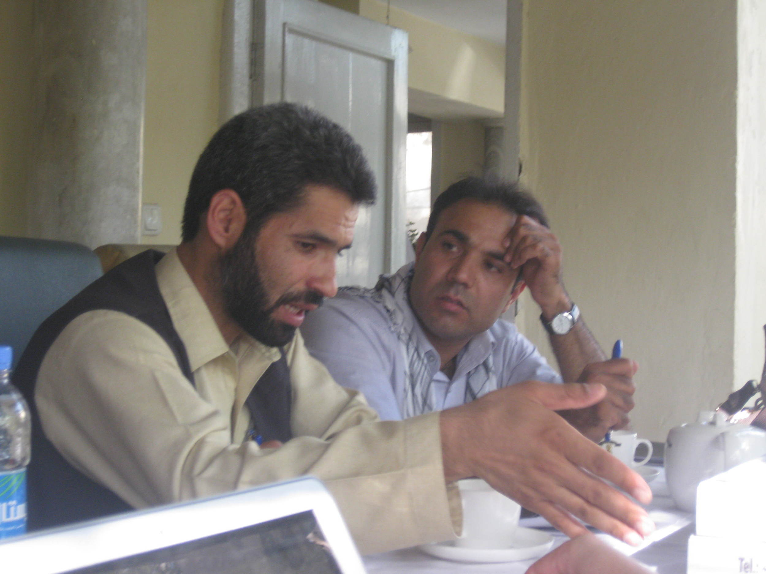 Zabiullah and Arman discuss things. Arman (right) has an amazing voice and sang some verses of the Koran as an auspicious opening for our workshop. He also showed me his Afghan pop music video!