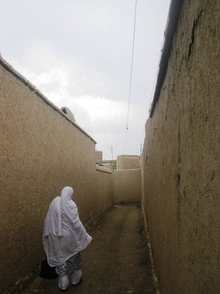 Nouria walks ahead.