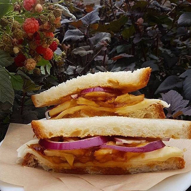 """""""Have""""arti we got a sandwich for you. It's truly the apple of our eye. Alume your already on you way over. But to caramelize the deal we know you will loaf it... This one was hard. . . Caramelized apples with havarti cheese, balsamic aioli and red onions. . . #sandwichoftheweek #trinitybellwoods #punqueen #🍎 #vegetarian"""