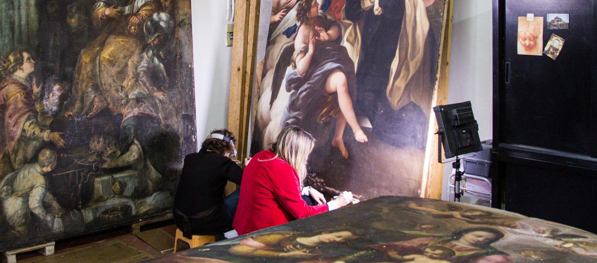 Conservators restoring masterwork by Violante Siries Cerroti