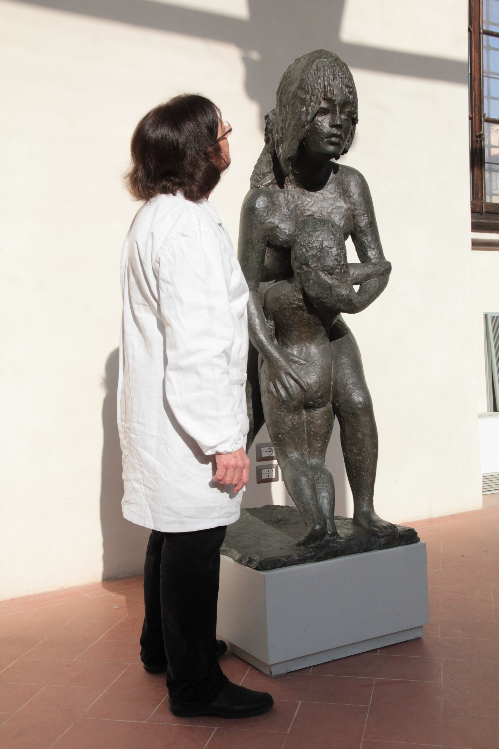 Examining an almost life-size sculpture pre-restoration