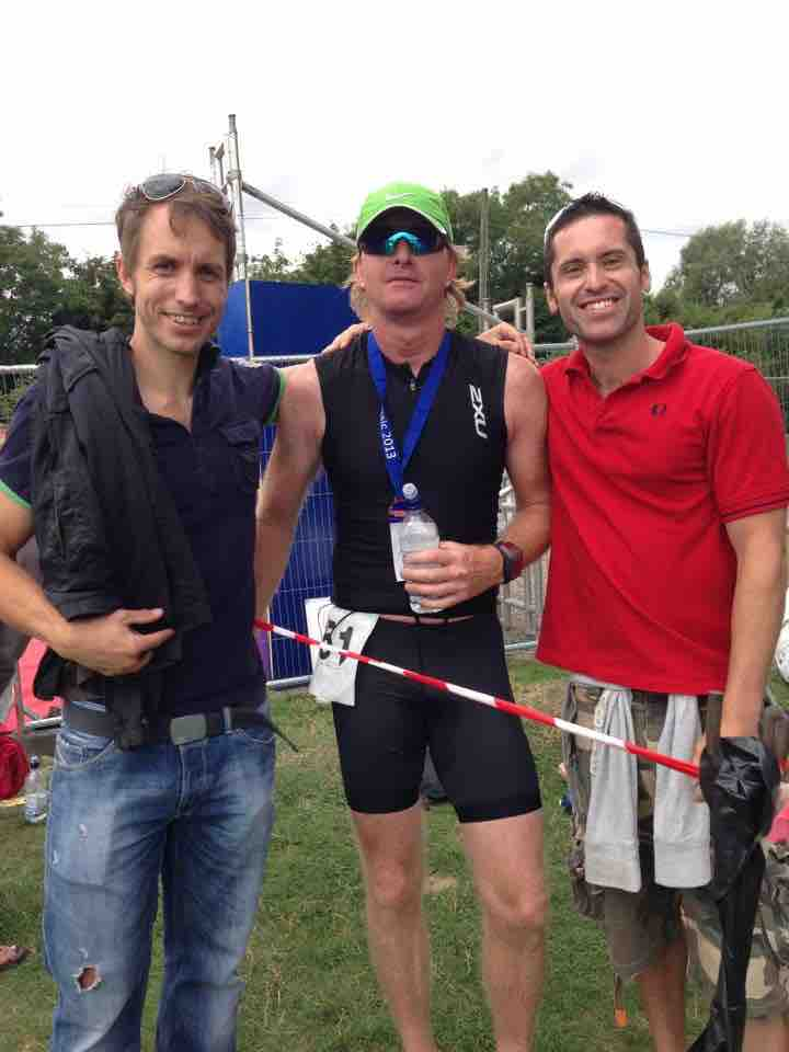 Simon and Paul watching Spencer complete Half Ironman