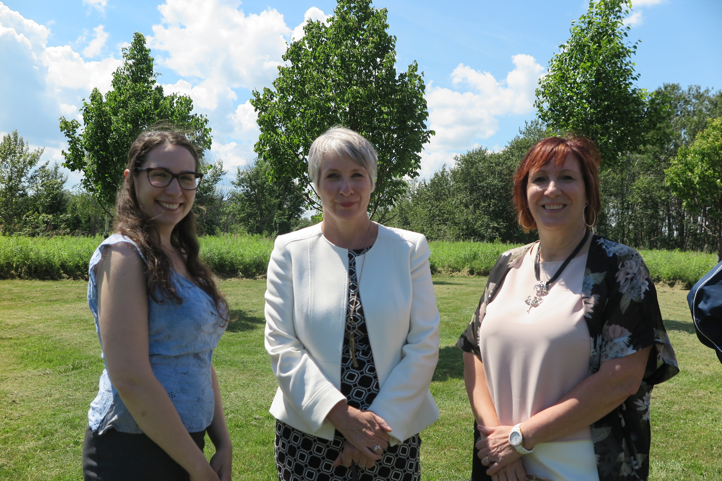 Youth intern Claire Thiébaut, the Honourable Patty Hajdu, Minister of Employment, Workforce Development and Labour and Member of Parliament for Thunder Bay-Superior North, and chair of Coopérative du ROFTB Inc. Claudette Gleeson