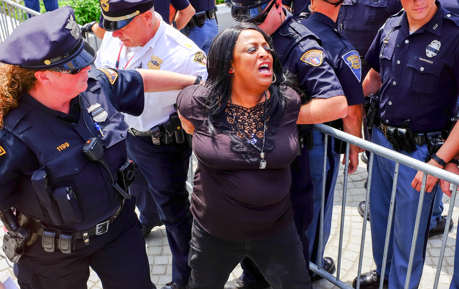 Kathy Wray Coleman, being arrested in Public Square,only minutes after speaking out about police brutality. She had an outstanding warrant for assaulting a police officer.