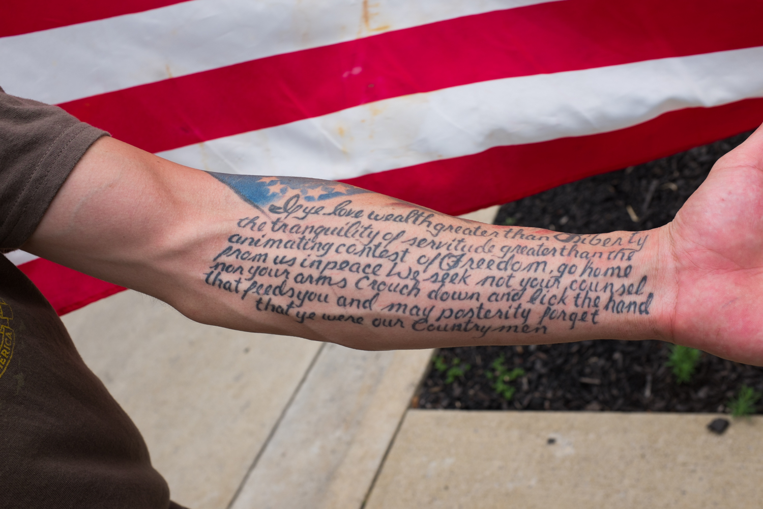 A quote by Sam Adams on Sean's arm.