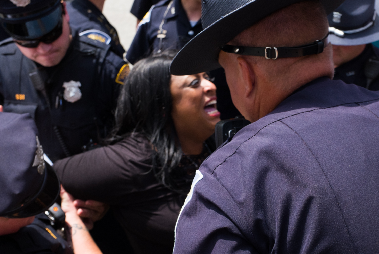 The Cleveland Police handcuff Kathy Wray Coleman.