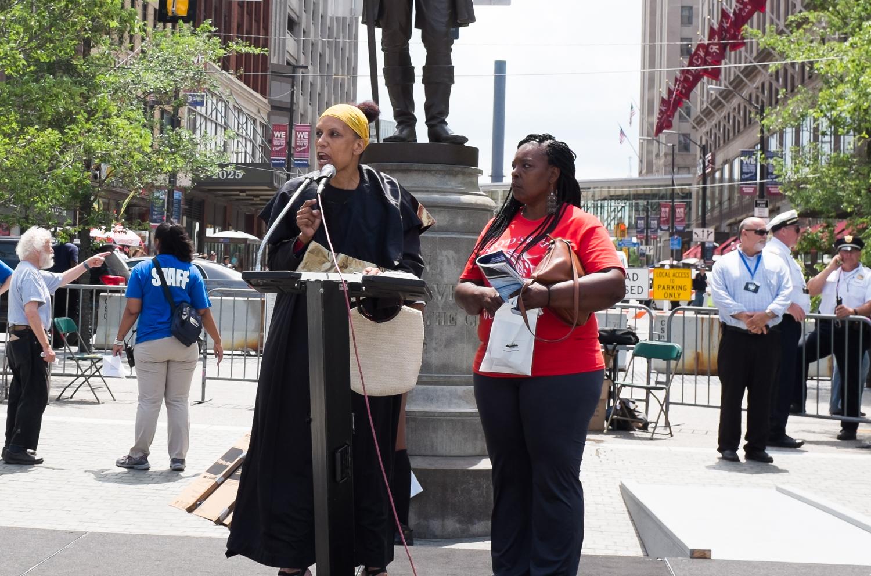 The Rev. Pamela M. Pickney Butts scolding the crowd after Coleman's arrest.