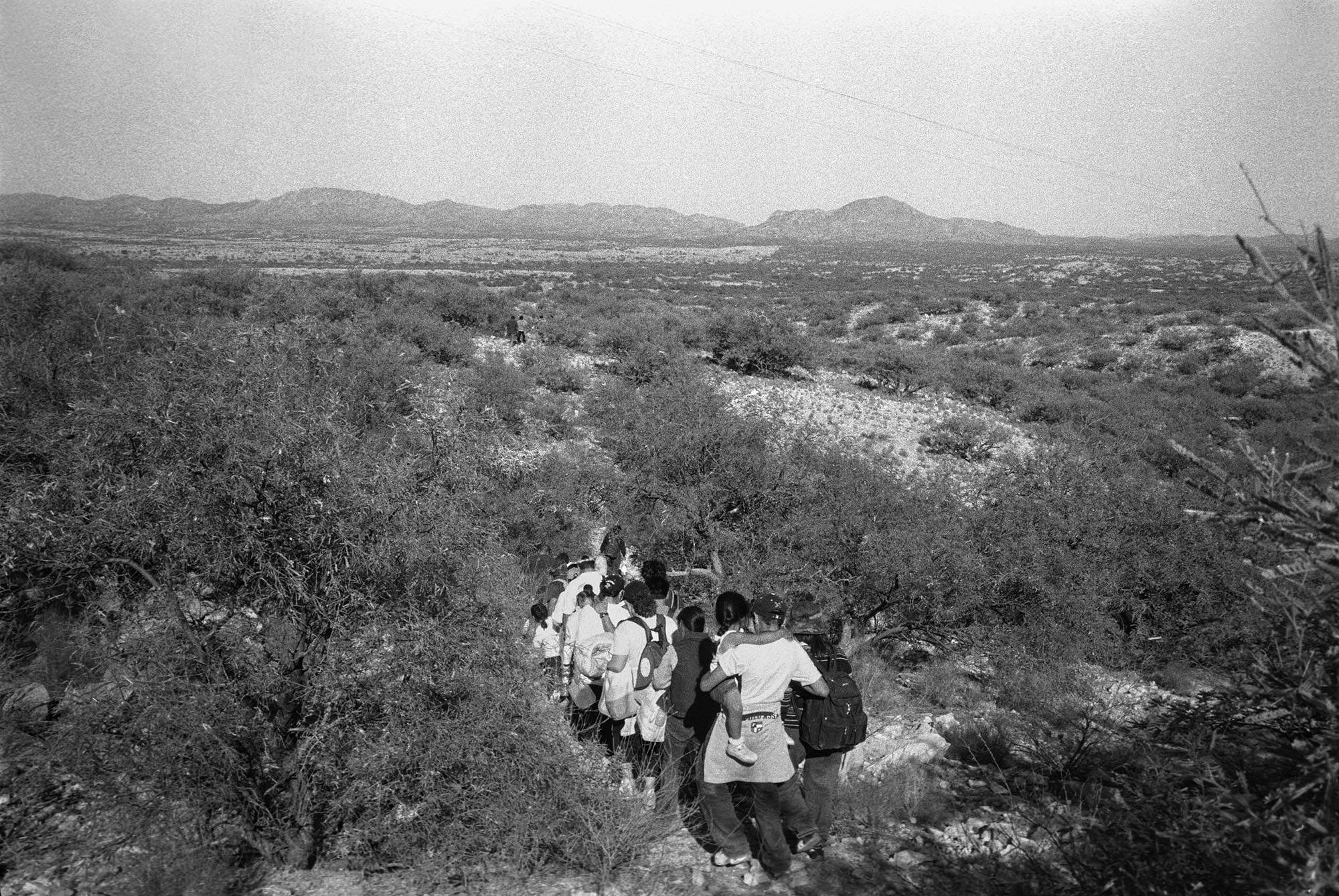 Migrants from Mexico crossing into the United States at the Buenos Aires National Wildlife Refuge near Sasabe, Arizona, 2005. Photo by  Julian Cardona.