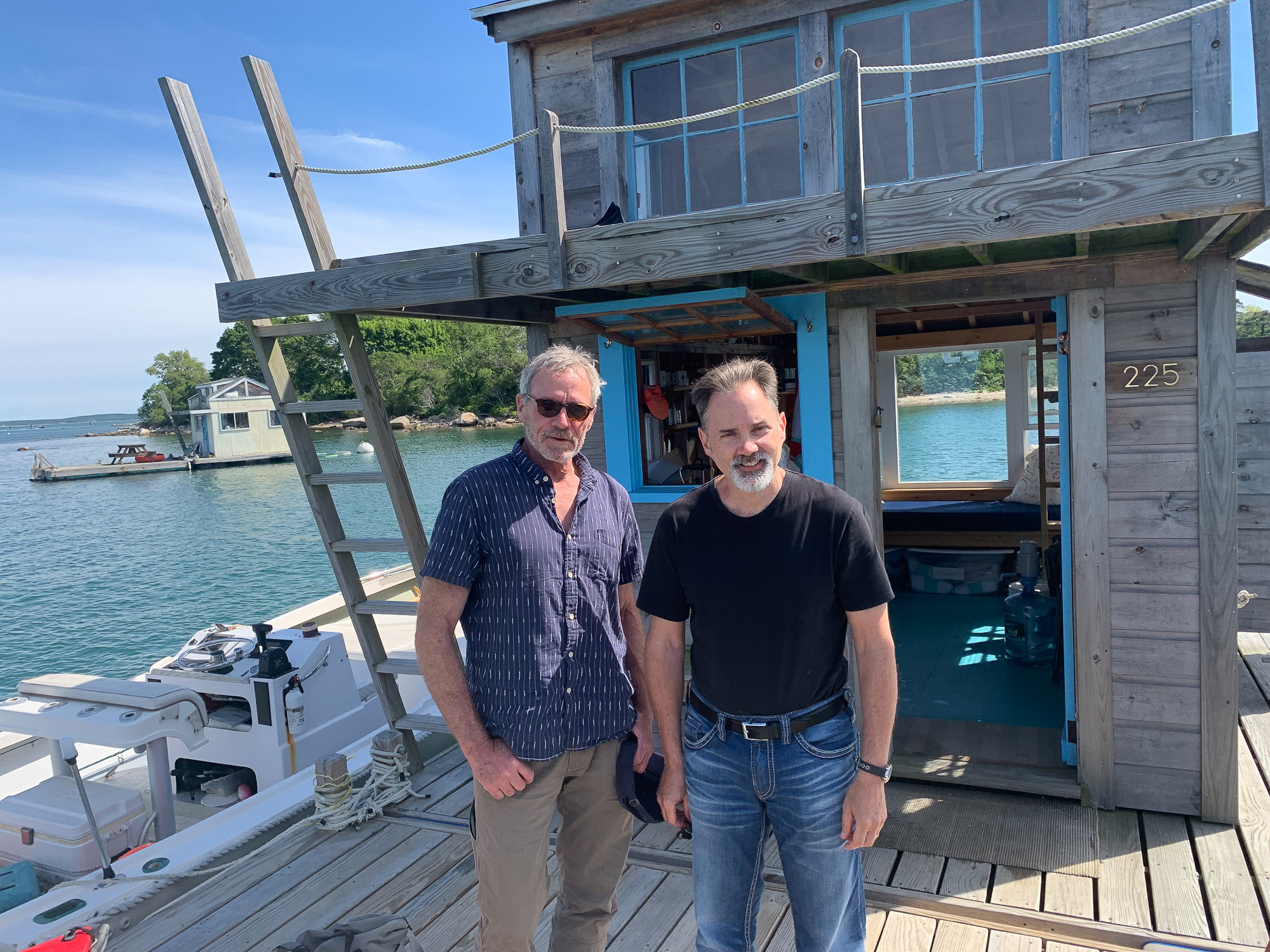 Scott Carrier and William J. Astore on the house raft in Woods Hole Harbor.