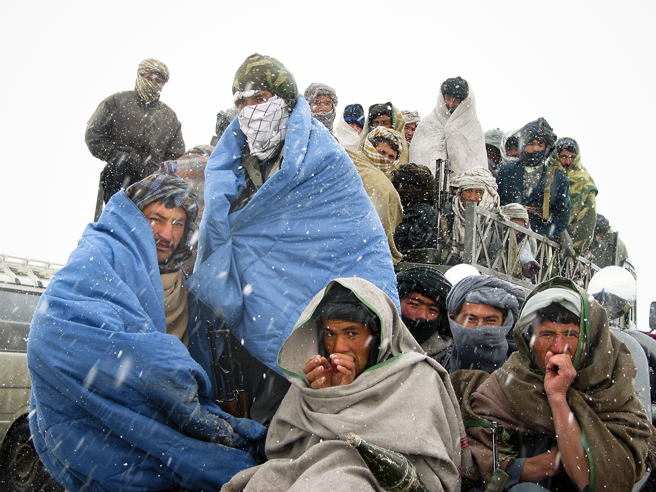 Balkh, Afghanistan  December 3, 2001  Northern Alliance soldiers wait in a snowstorm while their commanders negotiate the surrender of a group of Taliban still holding out in Balkh, Afghanistan.  PHOTOGRAPH by ALAN CHIN