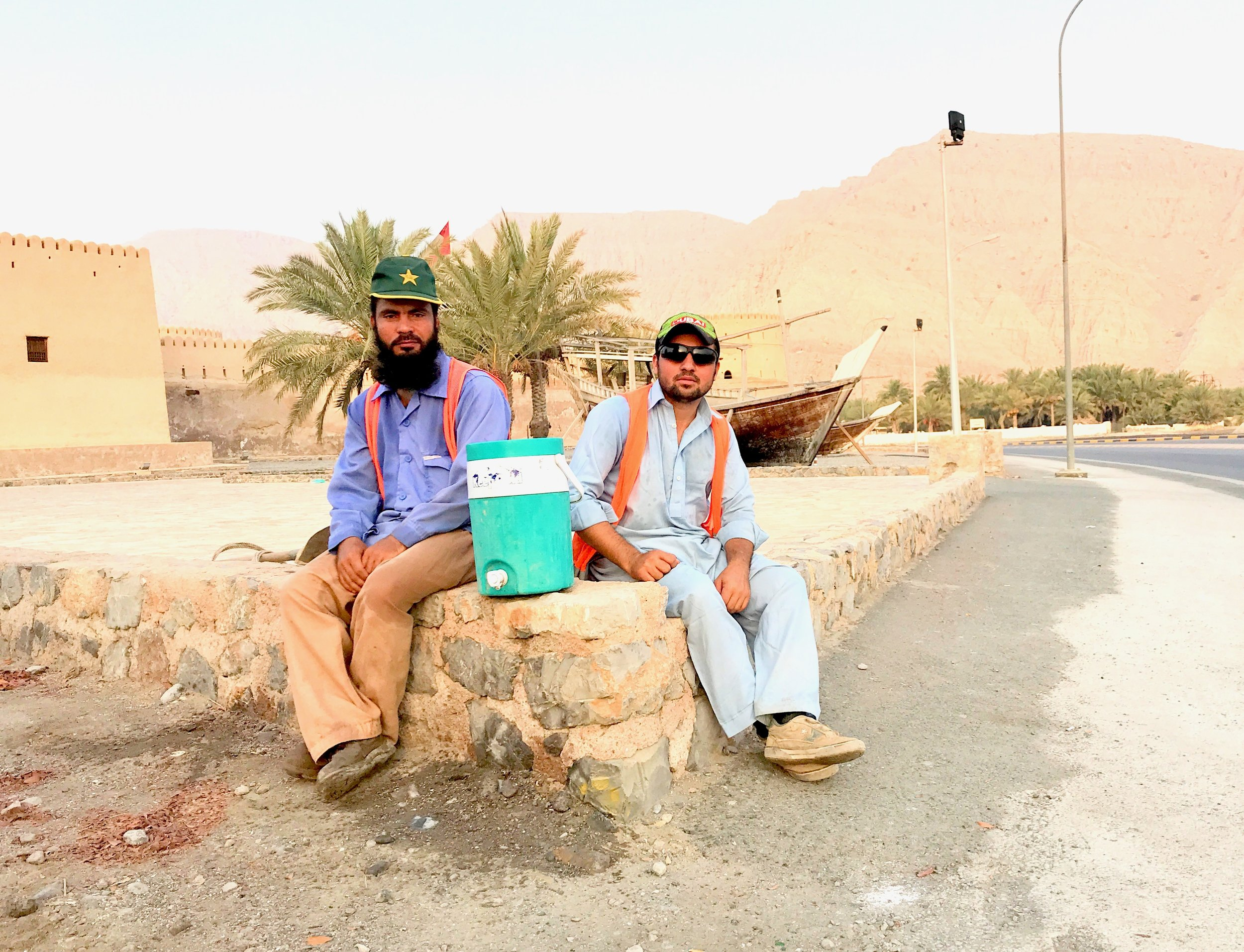 Workers taking a break in Khasab, Oman.