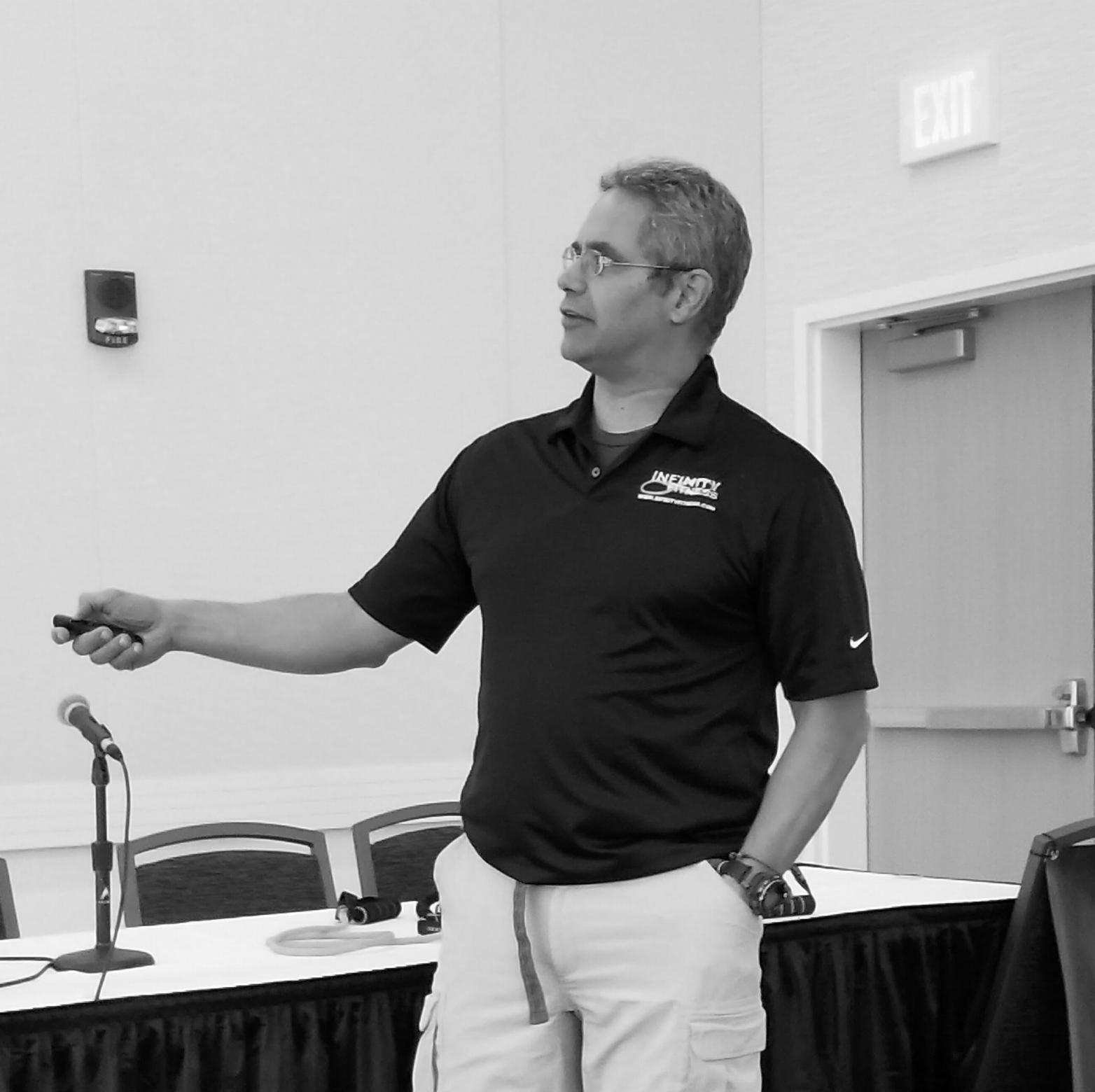 Eric Serran MD speaking 2.jpg