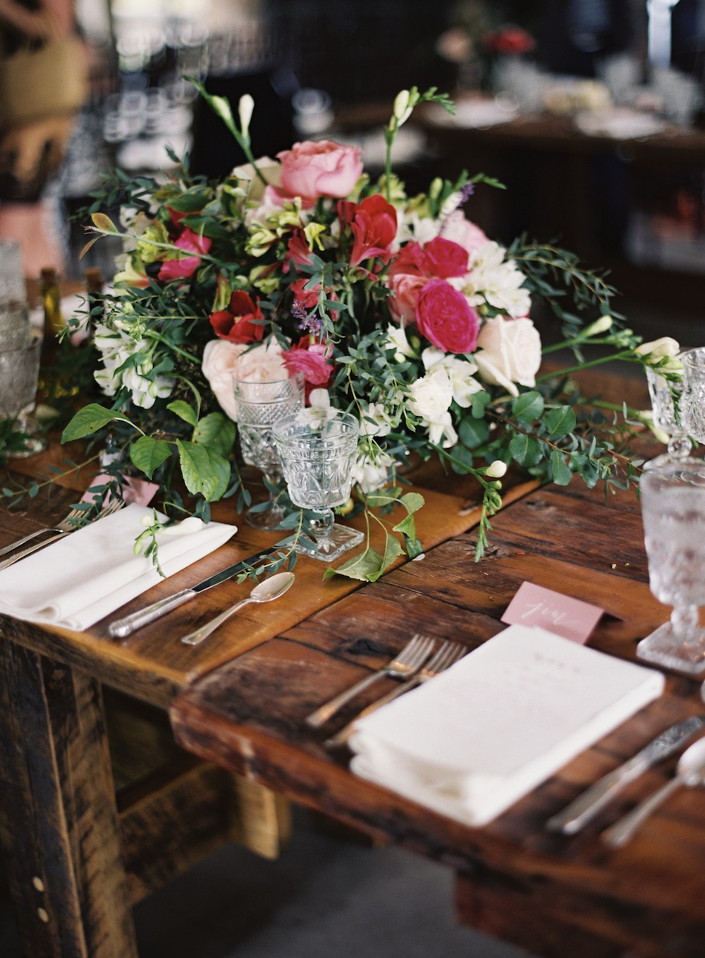 Southern Vintage rental silver flatware and clear stemware help create an elegant table setting!